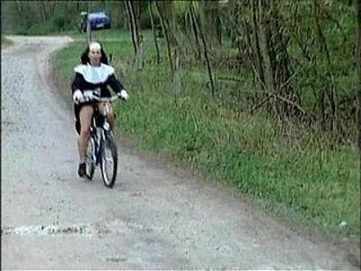 Nun on bike | -weird-